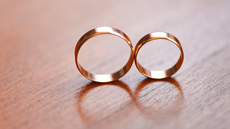 Two wedding rings in infinity sign. Love concept. Very small depth. - Image