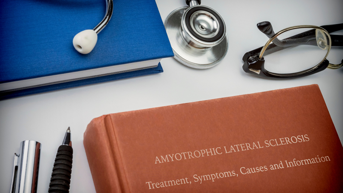 Titled book Amyotrophic Lateral Sclerosis along with medical equipment, conceptual image - Image