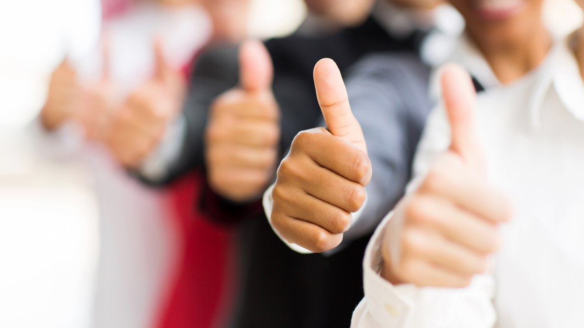 closeup portrait of business people giving thumbs up - Image