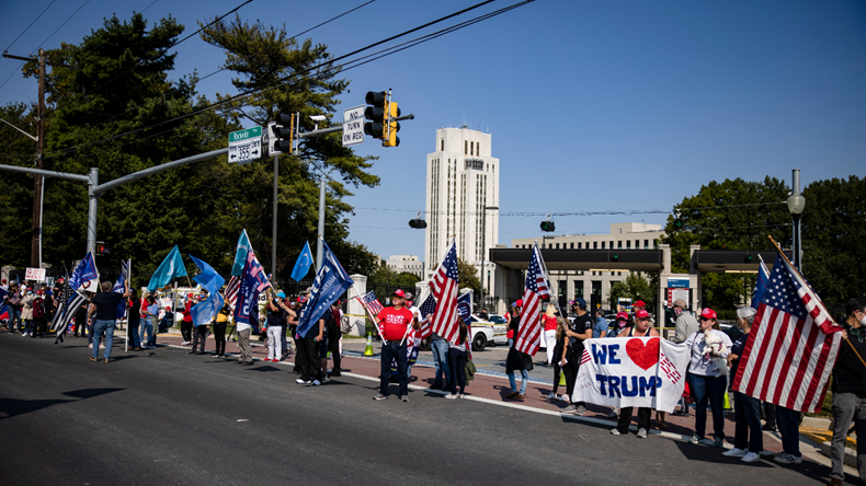 BETHESDA, MD - OCTOBER 04: Supporters of President Donald Trump gather outside of Walter Reed National Military Medical Center after the President was admitted for treatment of COVID-19 on October 4, 2020 in Bethesda, Maryland. The President announced via Twitter early Friday morning that he had tested positive. Numerous other prominent GOP figures and members of Congress have also tested positive in the last few days. (Photo by Samuel Corum/Getty Images)