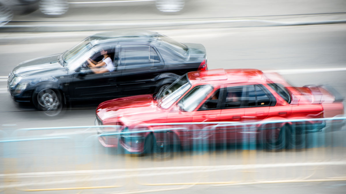 street cars racing in blurred action