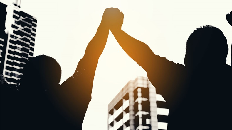 Two hand hold and join together in to sky,after everybody success something that they do,example win in game, success in business,market up volume sales.symbolizing to trust each other.
