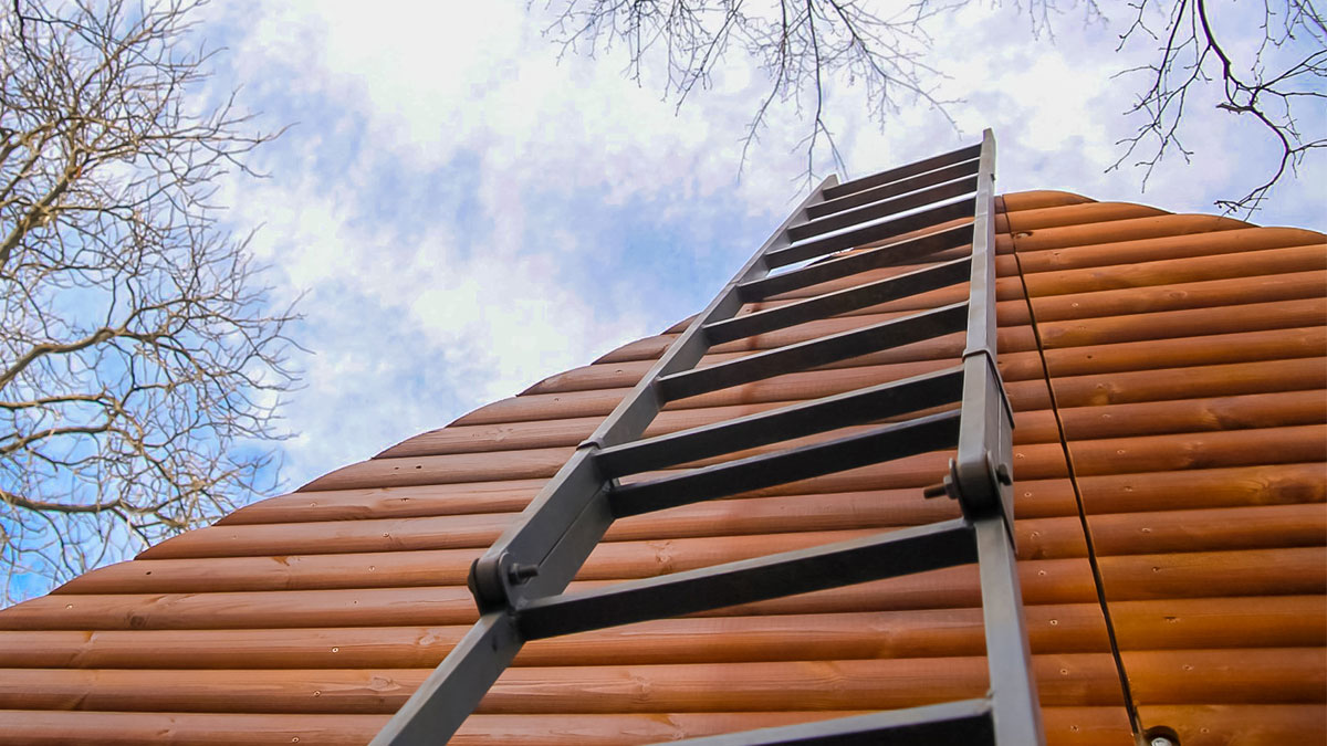 wooden ladder shot from below. getting up in the sky as a symbol of career and increase