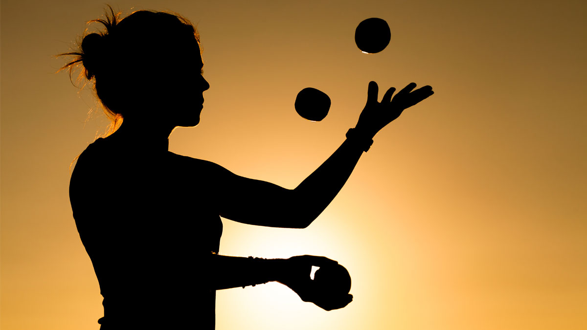 Silhouette of a Woman Juggling with Balls at Sunset - Image