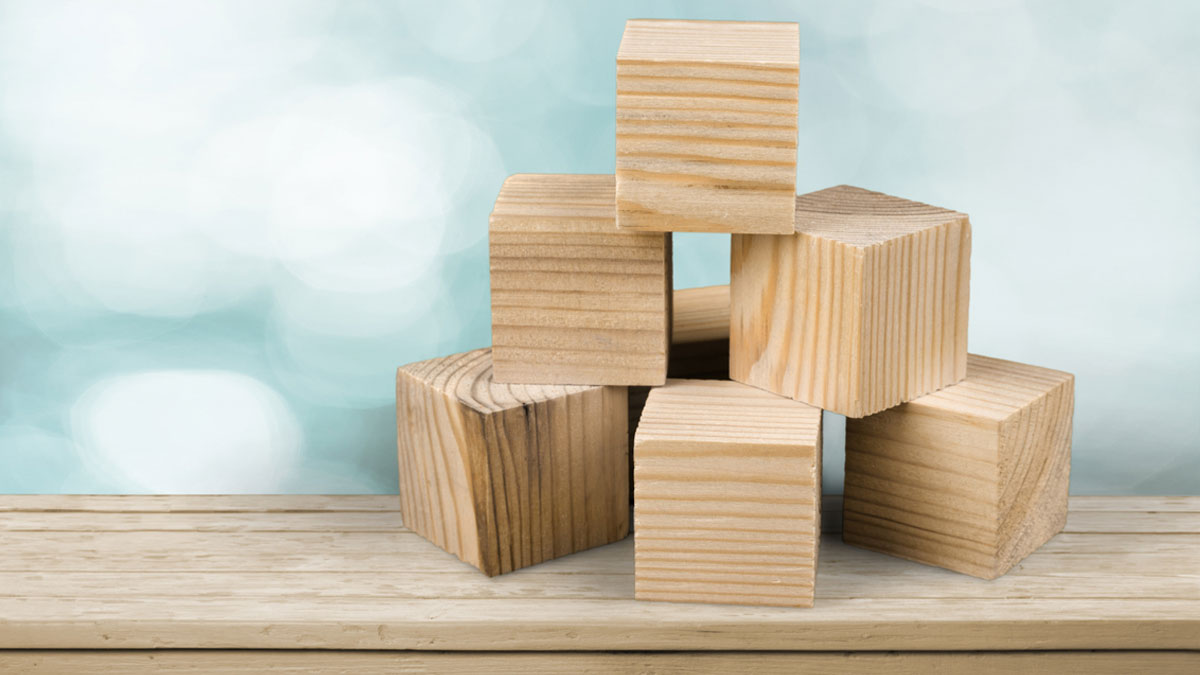 Wooden cubes on table background - Image