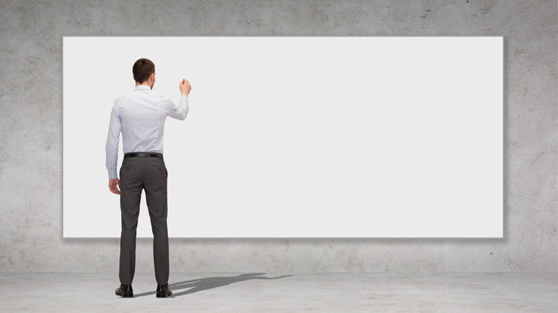 business, education and office people concept - businessman or teacher with marker writing or drawing something on white blank board over concrete wall background from back - Image