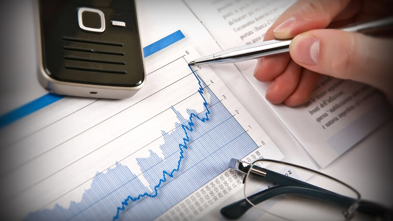 Businessman's hand showing diagram on financial report with pen. Business background 03 - Image