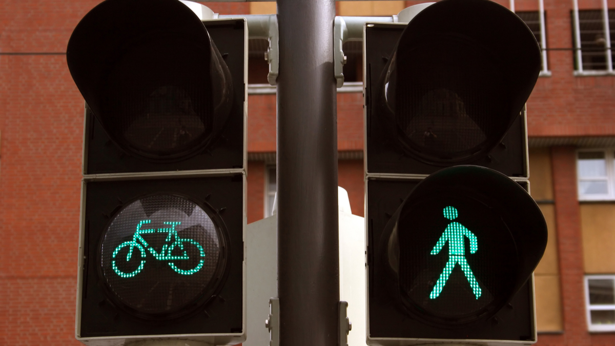 Green bicycle and pedestrian traffic lights, seen in Braunschweig, Germany - Image