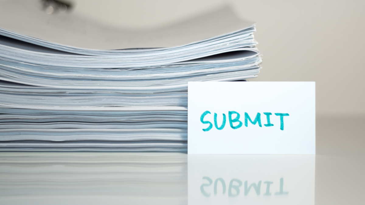 Submit; Stack of Documents on white desk and Background. - Image
