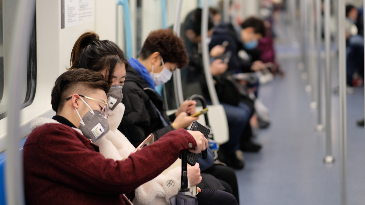 Shanghai/China-Jan.2020: New type coronavirus pneumonia in Wuhan has been spreading into many cities in China. People wearing surgical mask sitting in subway in Shanghai