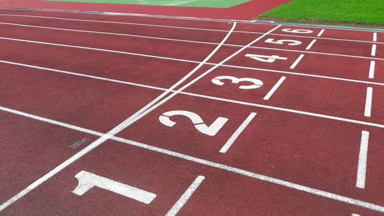 Numbers on red running track. Start and Finish point of a race track in a stadium