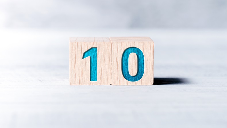 Number 10 Formed By Wooden Blocks On A White Table