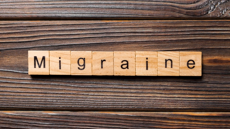 Migraine word written on wood block. Migraine text on wooden table for your desing, concept.