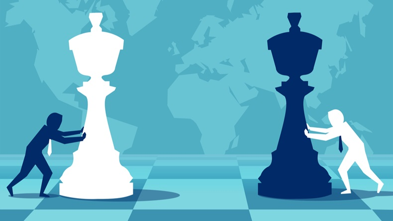 businessmen moving chess pieces on board of worldwide politics