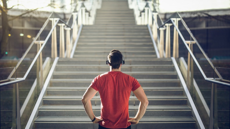 Man in red shirt preparing for stair run