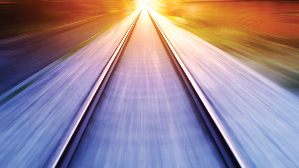 train fast run on railway track in sunny day