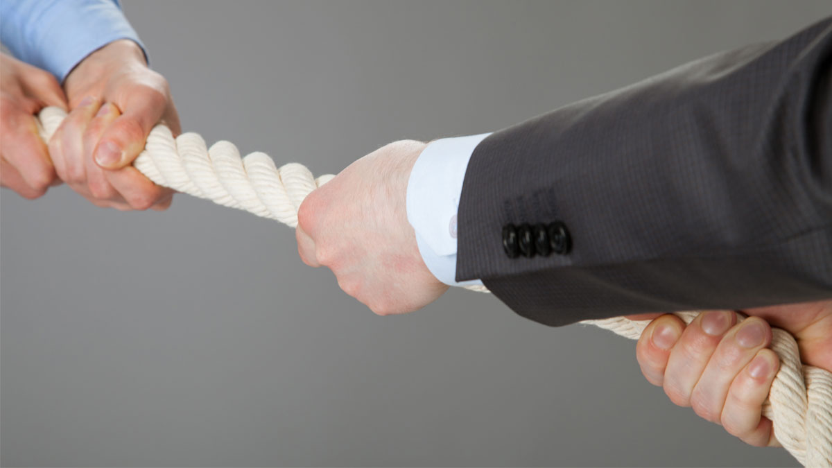 Two businessmen pulling a rope, closeup shot tug of war