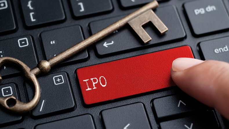 Closed up finger on keyboard with word IPO