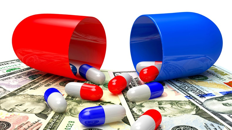US drug costs: Medical capsules spilled out of an open capsule on dollar bills. High costs of expensive medication concept