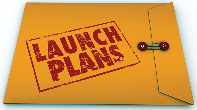 Launch Plans words stamped in red ink on yellow envelope offering advice, information