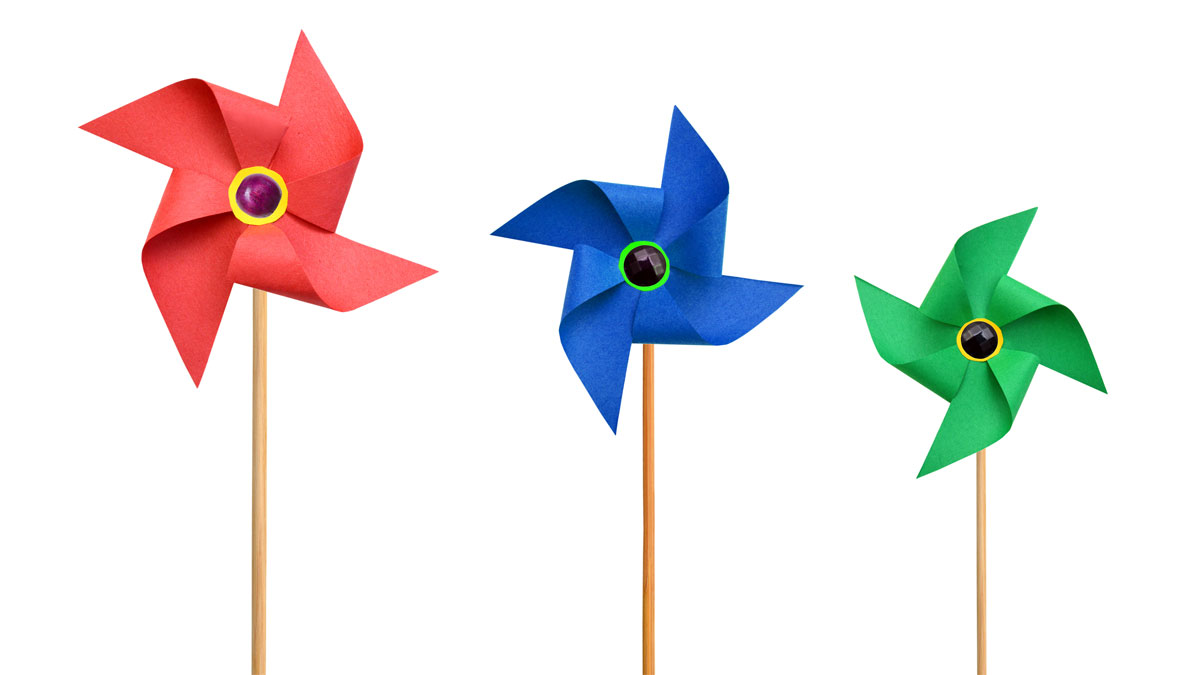 Three Paper pinwheels isolated on white background
