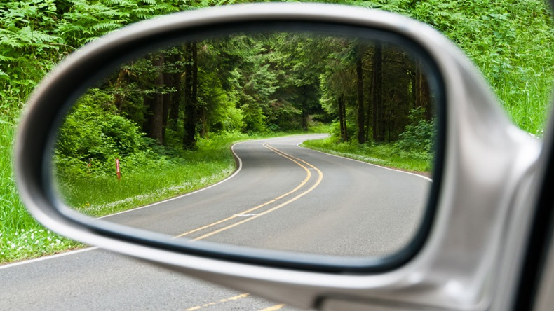 Side-view mirror on car looking back
