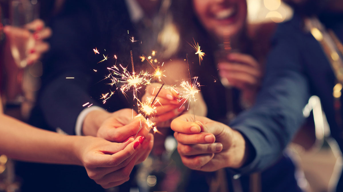 Picture showing group of friends having fun with sparklers - Image