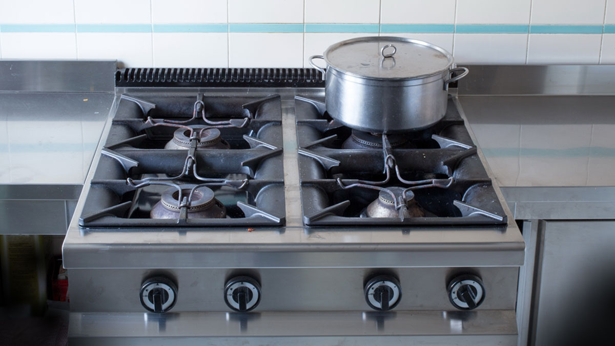 large pot over the stove's gas stainless steel industrial kitchen